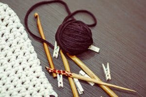 Crochet tools lay on the tablable